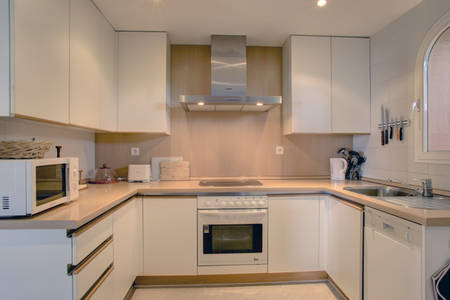 Image shows the kitchen with a range of modern fitted units.