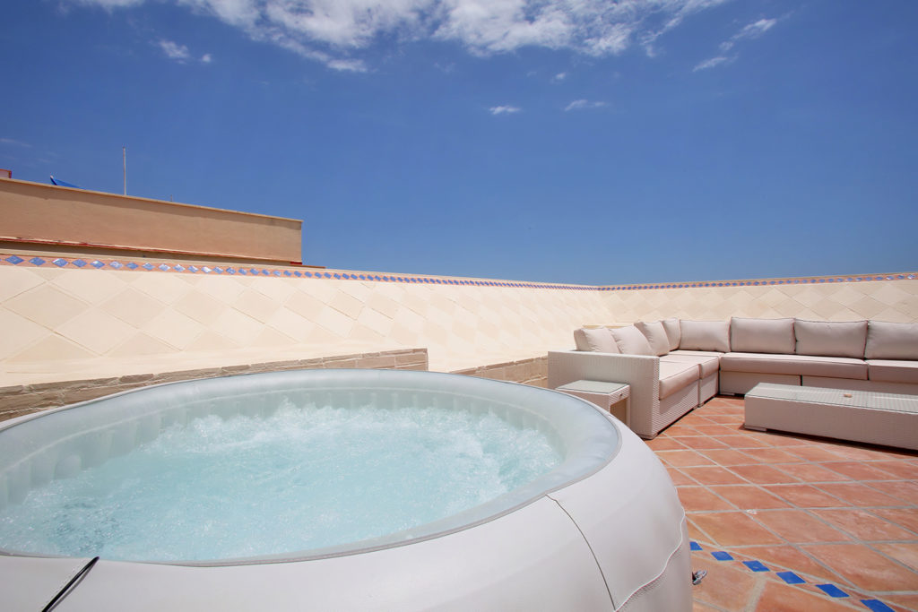 Image shows the private jacuzzi/hot tub on the rooftop for the exclusive use of the guests