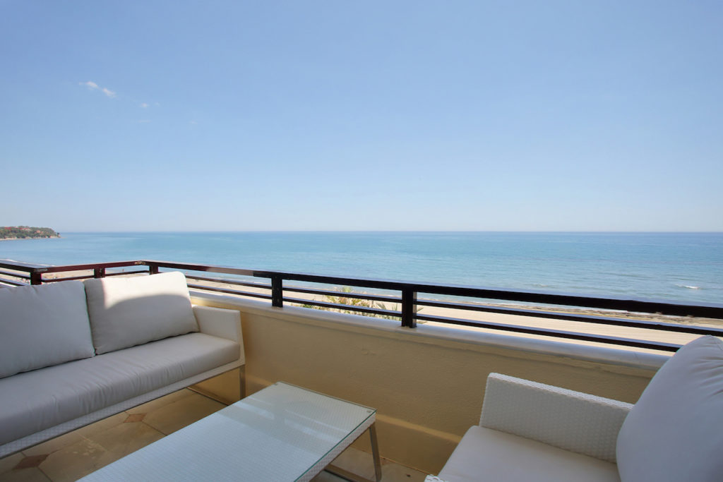 Image shows some of teh onge furniture at the edge of the roof terrace alloing a great view of the beach and sea.