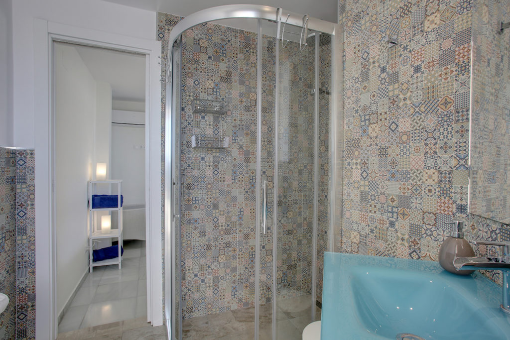 Image shows the third bathroom with its walk in shower cubicle