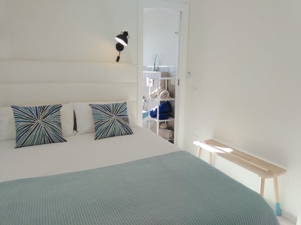 Image shows the third bedroom equipped with double bed.