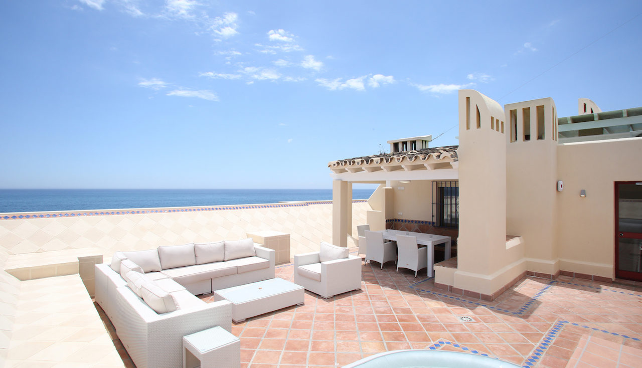 Private Roof Terrace of Mirasol Penthouse Apartment showing furniture and hot tub
