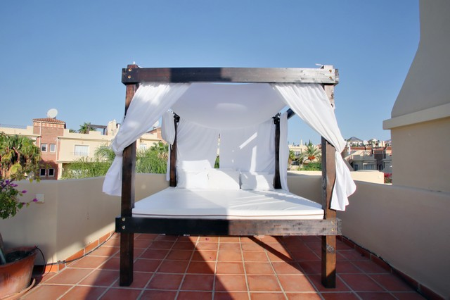 Image show picture of Balinesa on Roof Terrace along with matress, sheets pillows and curtains.