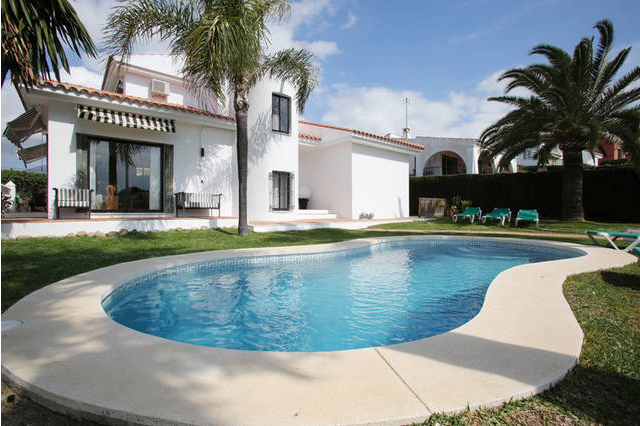 Estepona Holiday Rentals Villas - Villa Seghers. Image shows the pool and gardens in the foreground with loungers and the villa to the rear