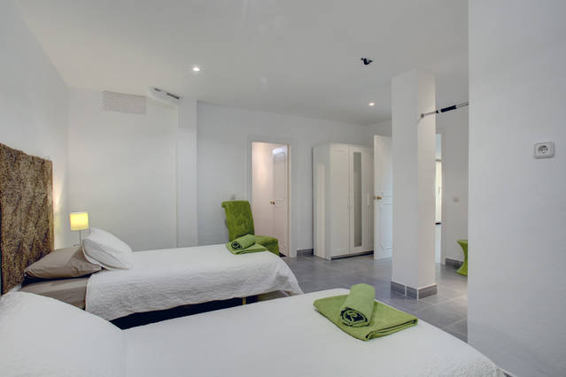 Image shows the 4th bedroom which is a large twin bedded room