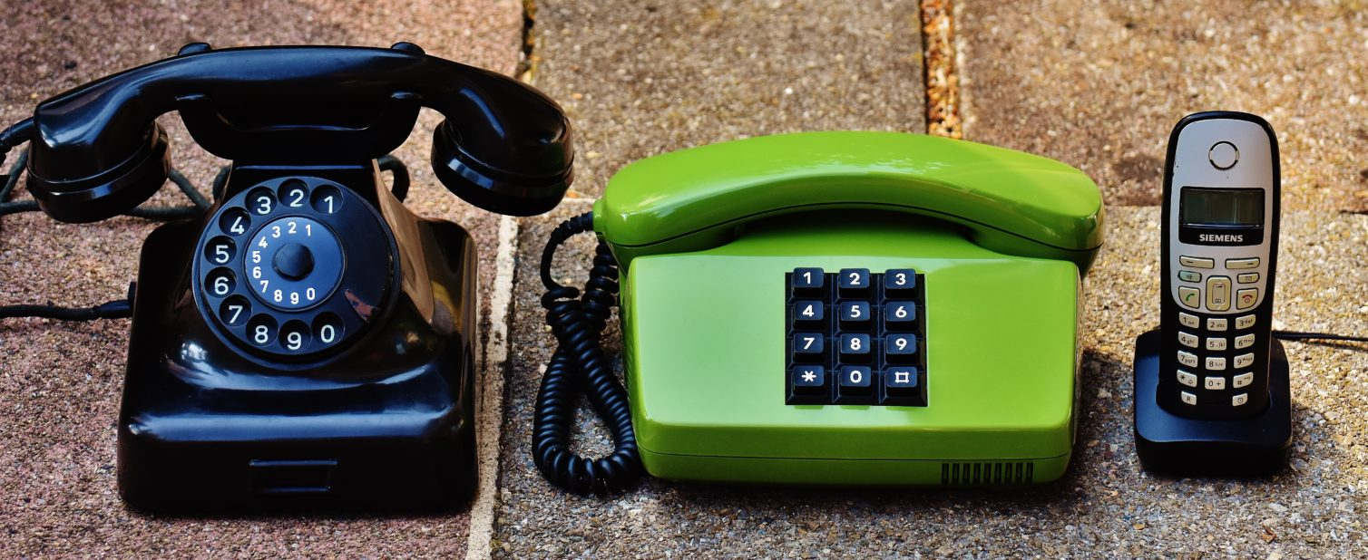 Contact us. Image shows several phone handsets of differing ages to show communication