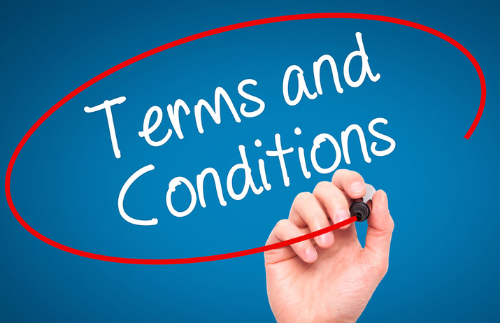 Image shows Terms and Conditions as a heading in white on a blue background and a hand drawing a circle round it with a red pen.