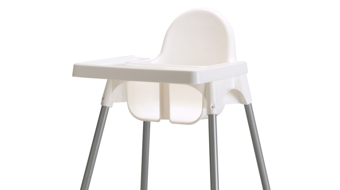 Image shows a white plastic high chair with stainless legs tipped with white plastic caps