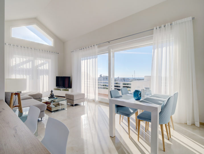 . Dream Holiday Rental Property. Image shows living rooms with views and large windows to walk on to the terrace