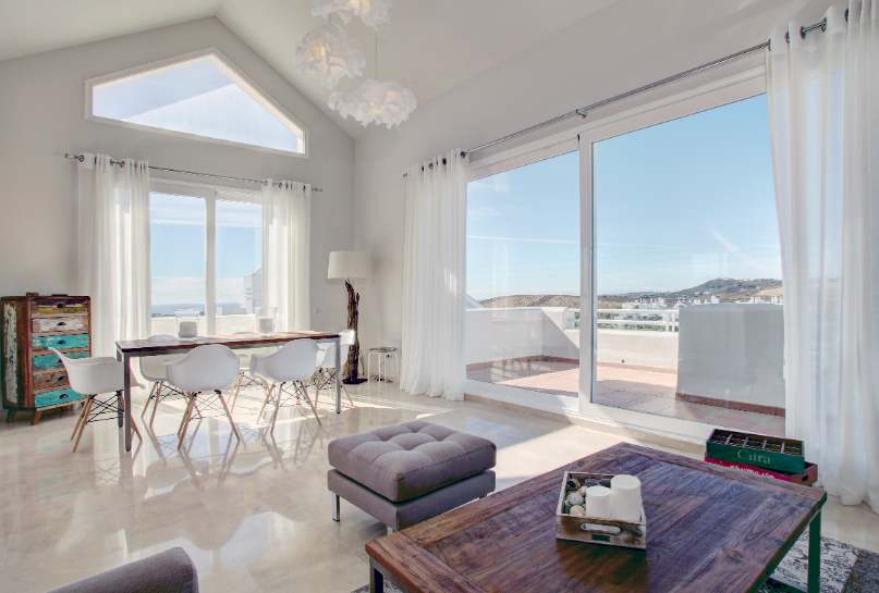 Image shows very large windows and terraces with stunning views