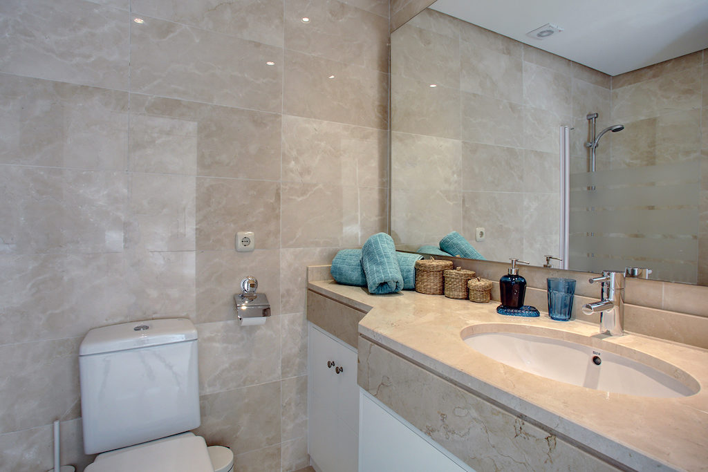 Image shows beautiful bathroom with fitted cabinets