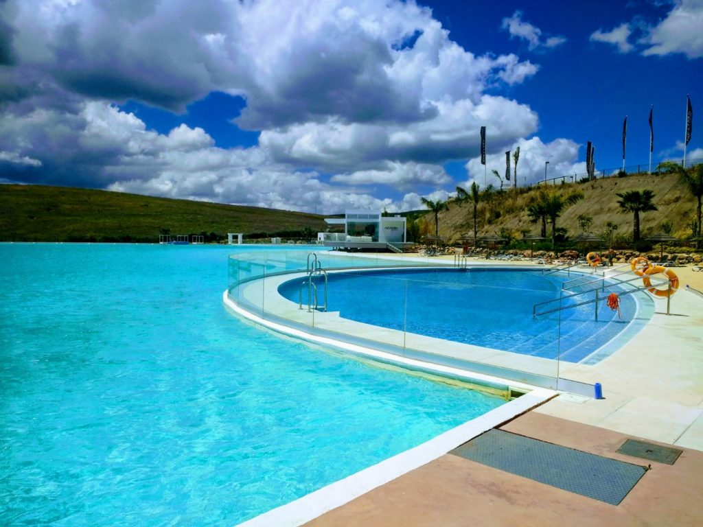 Image shows large pool in crystal lagoon