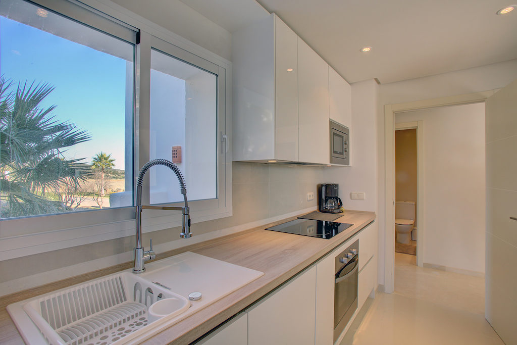 Image shows ultra modern kitchen