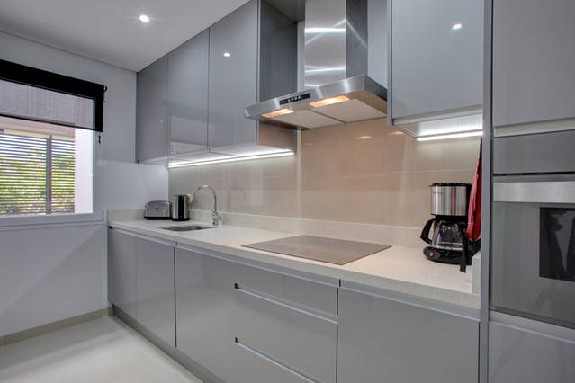 Image shows modern grey clor kitchen hob and cofee machine