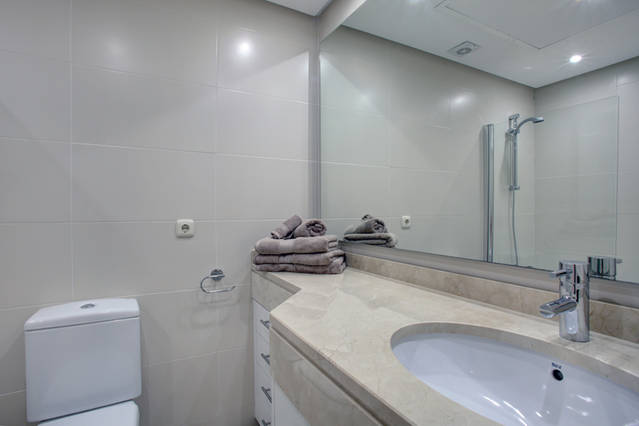 Image shows large marble bathroom mirrors