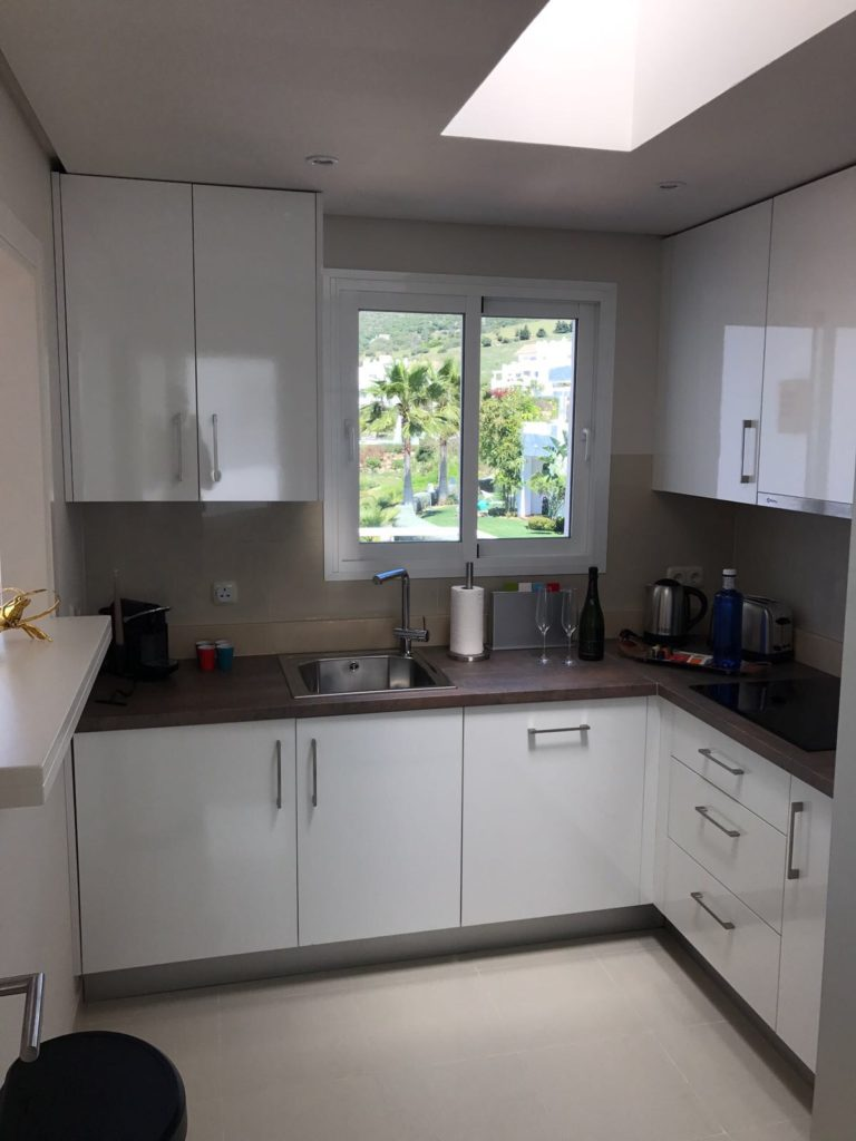 Image shows the recently refurbished kitchen of this stylish penthouse in Alcazaba Lagoon