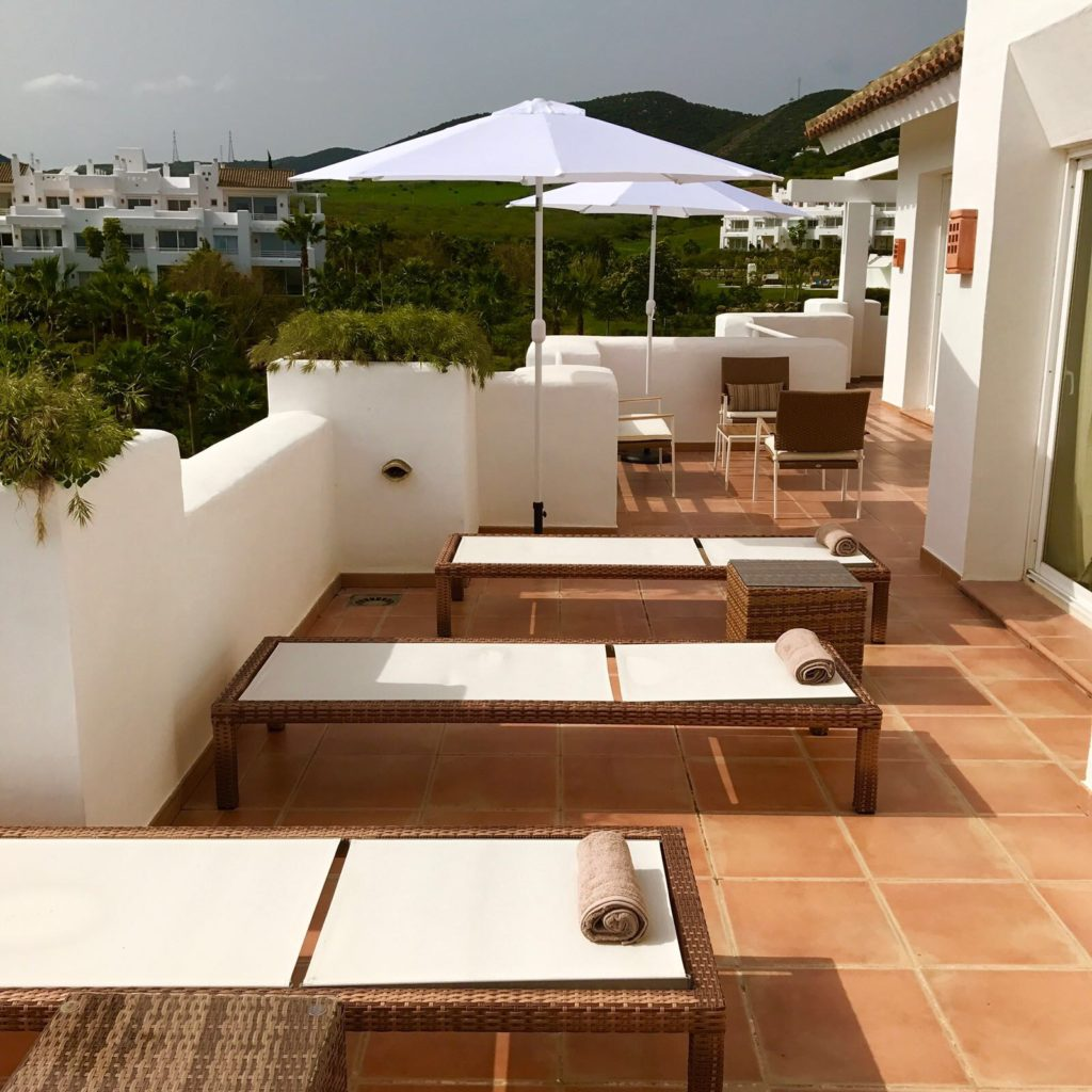 Image shows the second terrace with more outdoor furniture of this stylish penthouse in Alcazaba Lagoon