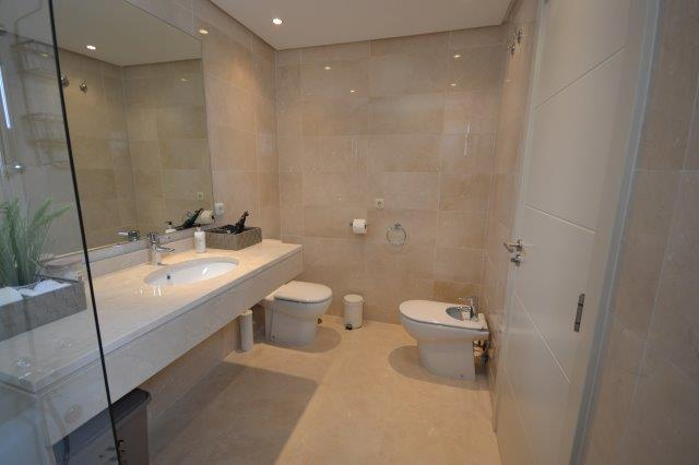 Image shows the en suite bathroom for the second bedroom of this stylish penthouse in Alcazaba Lagoon